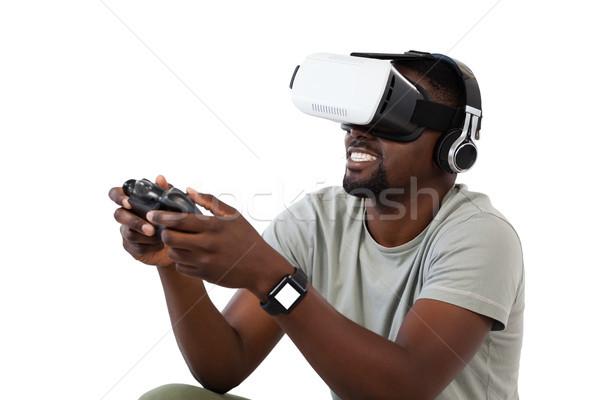 Hombre virtual realidad auricular jugando videojuegos Foto stock © wavebreak_media