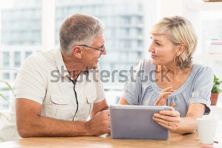 Doctor showing digital table to senior woman Stock photo © wavebreak_media