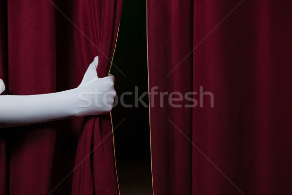 Close-up of hand in a white glove pulling curtain away Stock photo © wavebreak_media