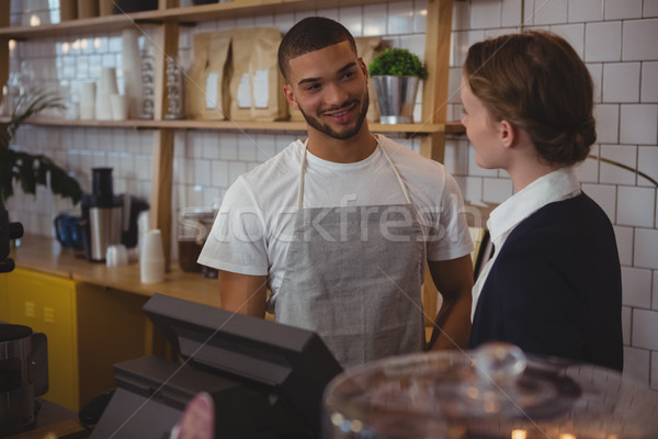 Owner talking with waiter in cafe Stock photo © wavebreak_media