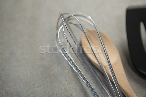 High angle view of wire whisk and wooden spoon Stock photo © wavebreak_media
