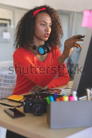 Beautiful woman matching color with color swatch Stock photo © wavebreak_media