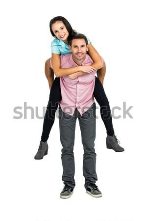 Mosolyog férfi malac hát barátnő fehér Stock fotó © wavebreak_media