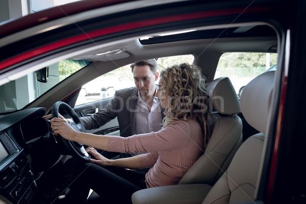 Salesperson assisting woman sitting in car Stock photo © wavebreak_media