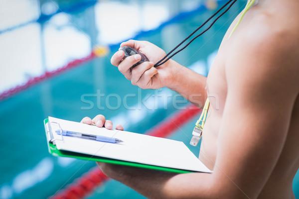 Przystojny trener stoper schowek basen Zdjęcia stock © wavebreak_media