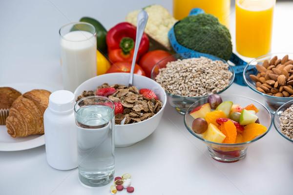 View ciotola cereali pillole alimentare bianco Foto d'archivio © wavebreak_media