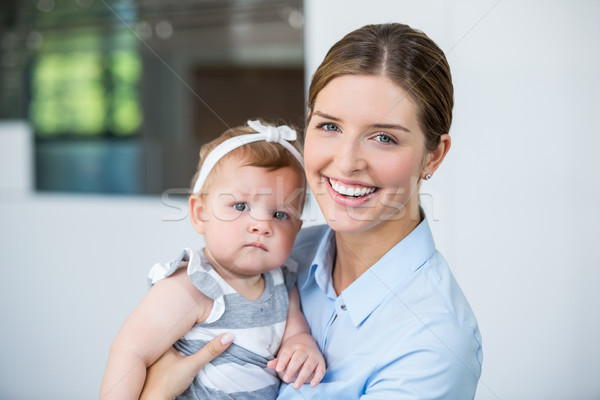Happy woman carrying baby girl  Stock photo © wavebreak_media
