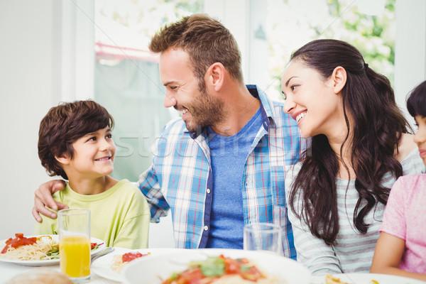 笑みを浮かべて 両親 見える ダイニングテーブル ホーム ストックフォト © wavebreak_media