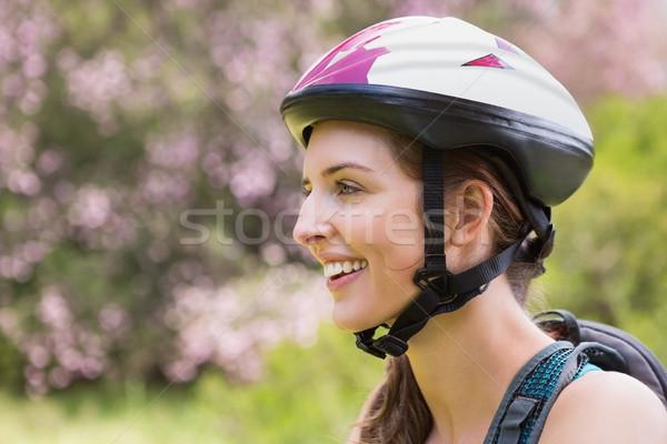 Smiling woman wearing a helmet Stock photo © wavebreak_media