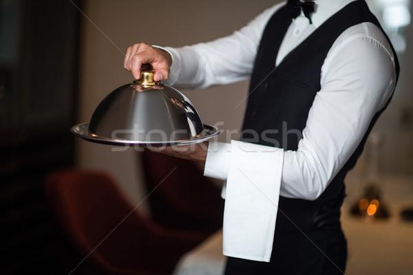 Guapo camarero bandeja comerciales cocina Foto stock © wavebreak_media