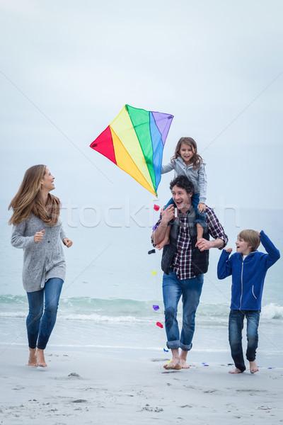 Gelukkig gezin Kite genieten zee wal Stockfoto © wavebreak_media