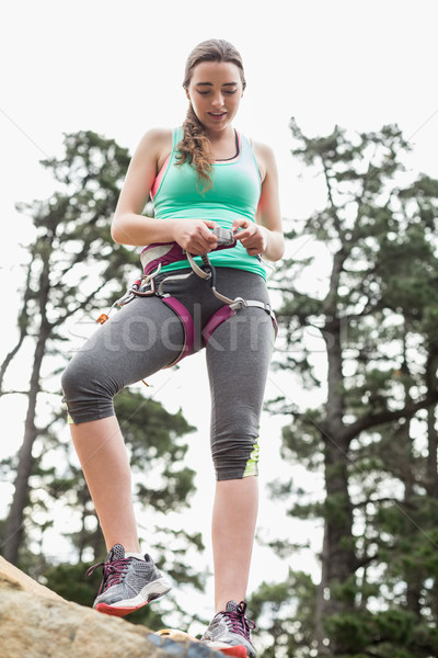 Low angle view of young woman on rock Stock photo © wavebreak_media