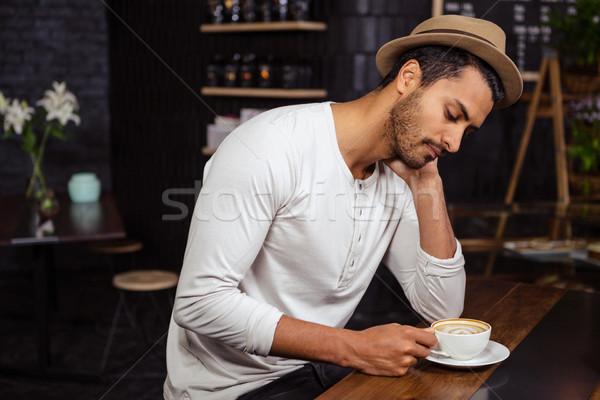 Sad man holding his coffee Stock photo © wavebreak_media