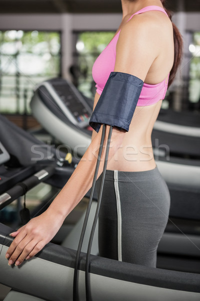 Mid section of woman exercising on treadmill with mobile on armb Stock photo © wavebreak_media