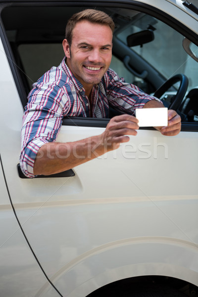 Young man showing his drivers license Stock photo © wavebreak_media