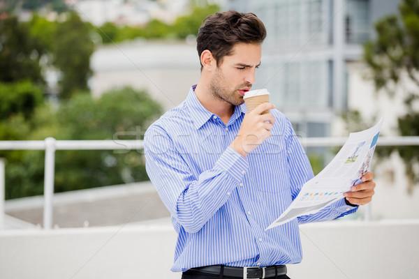 Businessman reading a newspaper Stock photo © wavebreak_media