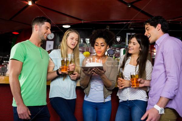 Friends celebrating with cake Stock photo © wavebreak_media