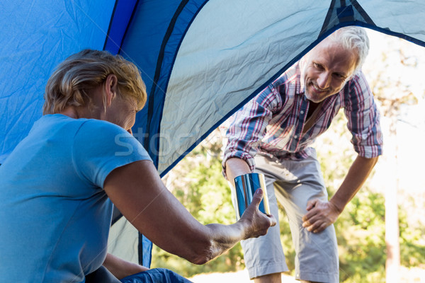 Senior couple relaxing inside their tent Stock photo © wavebreak_media