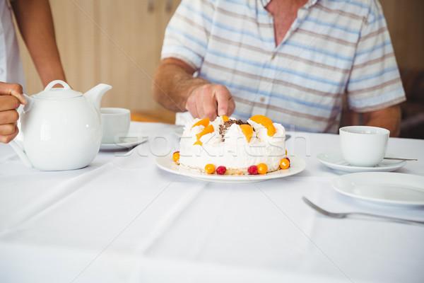 Patient is cutting the cake  Stock photo © wavebreak_media