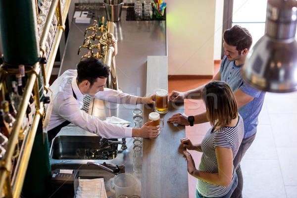 бармен пива пару мнение Сток-фото © wavebreak_media