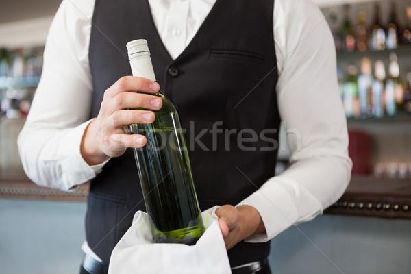 Waiter holding a bottle of wine Stock photo © wavebreak_media