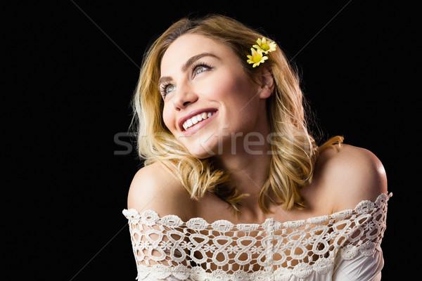 Gyönyörű mosolygó nő fekete közelkép virág divat Stock fotó © wavebreak_media