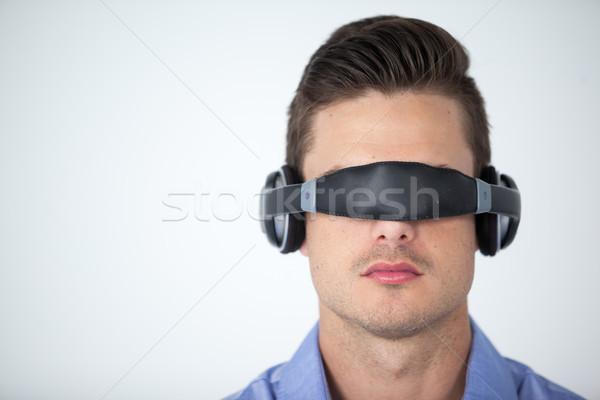 Man using virtual video glasses Stock photo © wavebreak_media