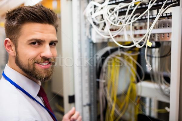 Sorridente técnico em pé servidor quarto retrato Foto stock © wavebreak_media