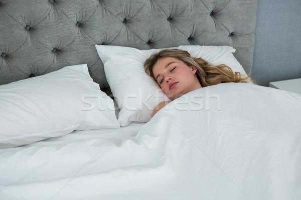 Fiatal nő alszik ágy hálószoba otthon nő Stock fotó © wavebreak_media