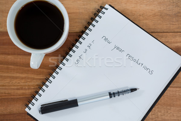 Close-up of coffee cup with diary and pen Stock photo © wavebreak_media