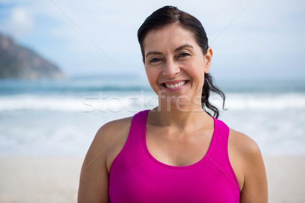 Portrait of smiling woman on beach Stock photo © wavebreak_media