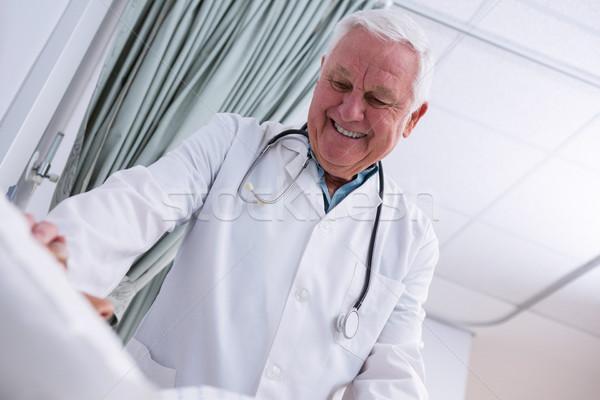 Doctor consoling senior patient Stock photo © wavebreak_media
