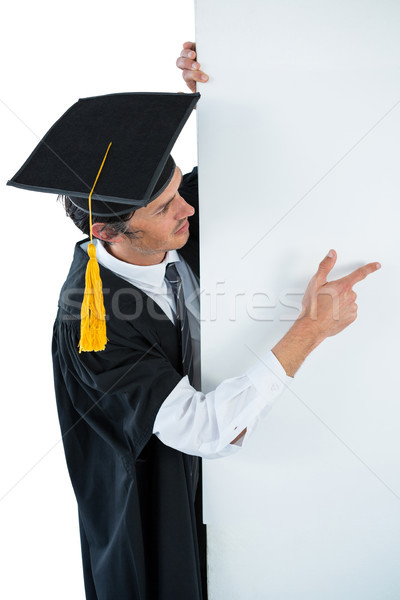 Male graduate student behind a panel and pointing with finger Stock photo © wavebreak_media