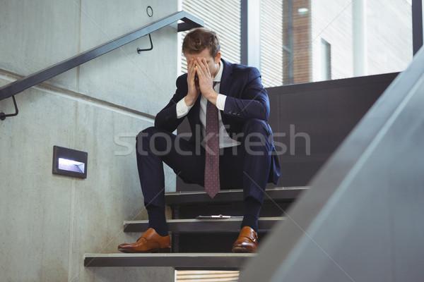 Depressed businessman sitting on stairs Stock photo © wavebreak_media