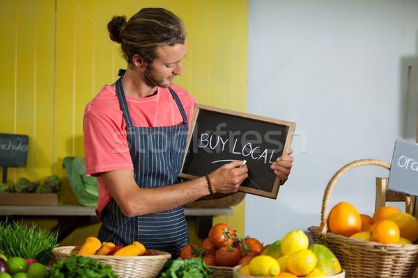 Male staff writing on slate board in organic section Stock photo © wavebreak_media