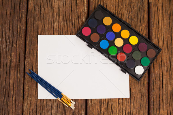 Paint brushes, watercolor palette and white paper Stock photo © wavebreak_media
