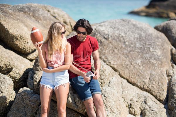 çift konuşma oturma kaya oluşumu plaj adam Stok fotoğraf © wavebreak_media