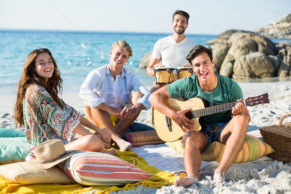 Portrait of happy friends enjoying on shore Stock photo © wavebreak_media