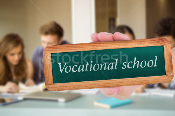 Vocational school against smiling friends students revising toge Stock photo © wavebreak_media
