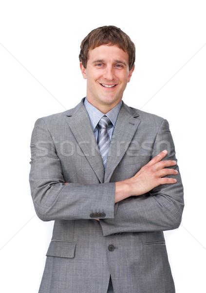 Charismatische zakenman gevouwen armen geïsoleerd witte Stockfoto © wavebreak_media