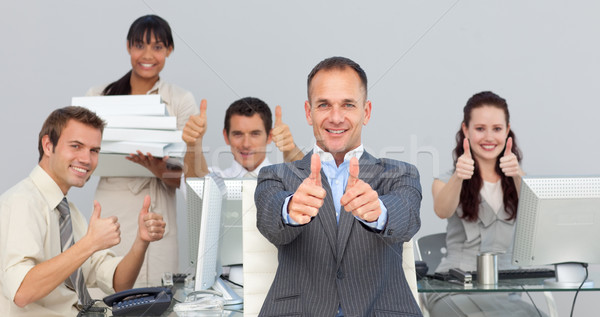 Assertive manager and his team with thumbs up  Stock photo © wavebreak_media