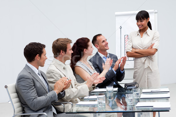 Business people applauding a colleague after reporting to sales figures Stock photo © wavebreak_media