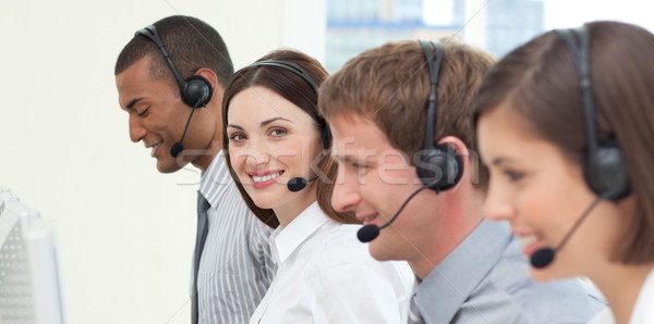 Jóvenes gente de negocios auricular de trabajo centro de llamadas ordenador Foto stock © wavebreak_media