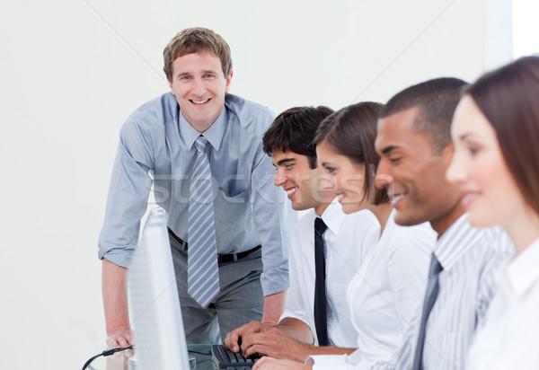 Gestionnaire équipe travail ordinateurs affaires ordinateur Photo stock © wavebreak_media