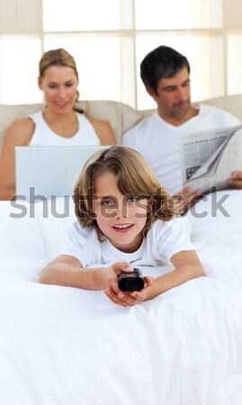 Enthusiastic little boy holding a remote Stock photo © wavebreak_media