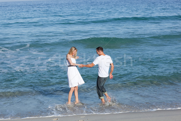 Joyful lovers having fun at the seaside Stock photo © wavebreak_media