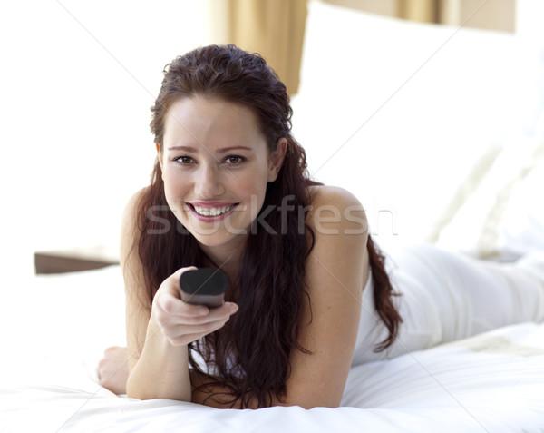 красивая женщина спальня пультом улыбаясь девушки Сток-фото © wavebreak_media