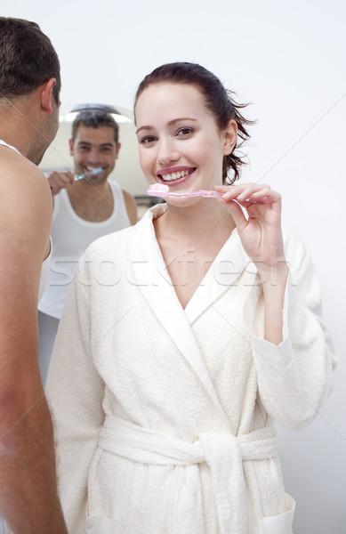 Nő férfi takarítás fogak fürdőszoba vonzó nő Stock fotó © wavebreak_media