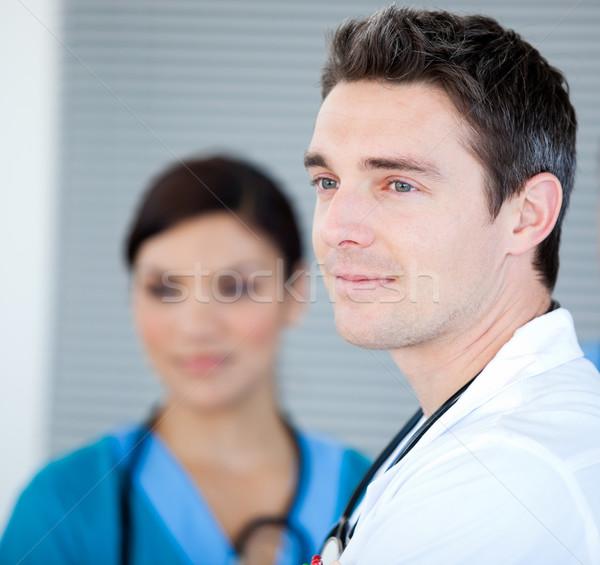 Karizmatikus férfi orvos néz ablak kórház boldog Stock fotó © wavebreak_media