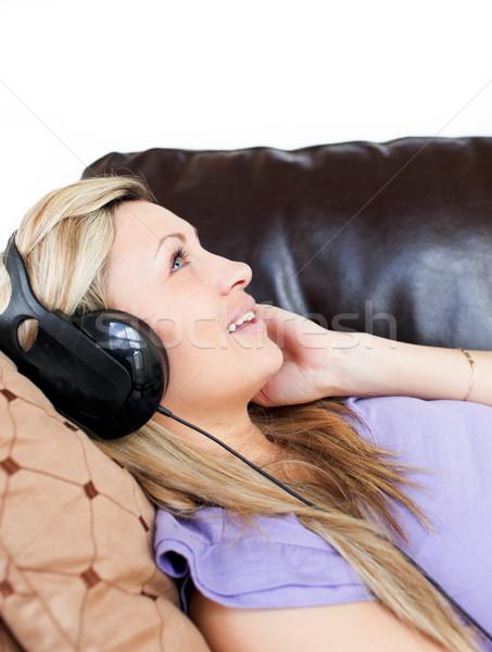 Cute vrouw hoofdtelefoon sofa gelukkig rock Stockfoto © wavebreak_media